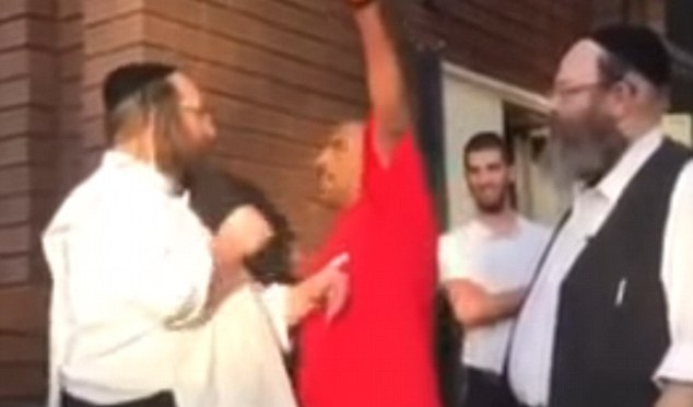 The shocking moment a man tries to strangle an Orthodox Jew outside a Melbourne synagogue and screams 'swear to Allah' in his face – but HE is slammed to the ground by his much bigger target